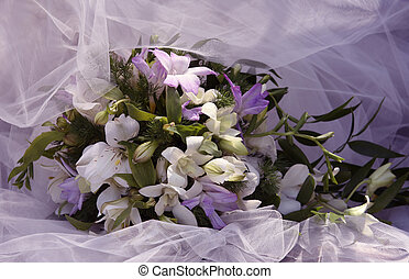 Wedding bouquet on a background of a veil