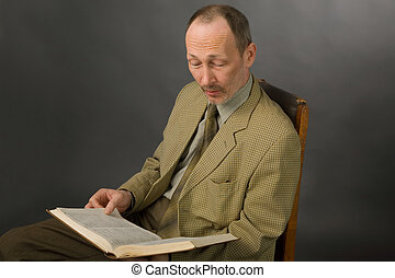 professor - the portrait of senior man with book