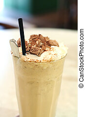 Iced coffee - Cup of iced milk coffee in glass with straw