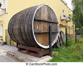 Old wooden barrel for beer near the pub