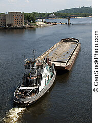 Tug boat with barge on the river