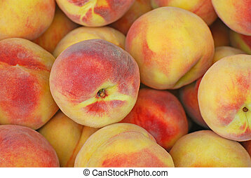 Fresh Peaches - Fesh peaches in a pile with the focus on one...