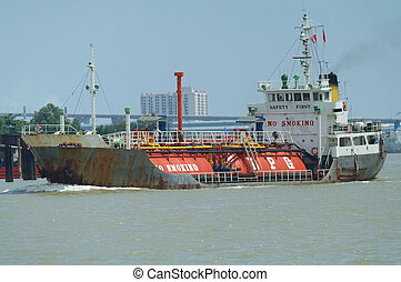 LPG ship on a river - LPG (Liquefied Petroleum Gas) ship,...
