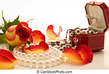 jewelries and flowers - set of jewelries and rose over white...