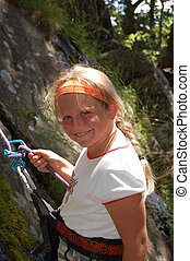 Young girl rappelling - closeup of a young girl rappelling...