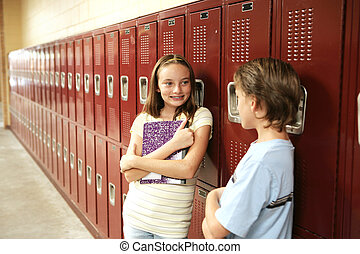 Between Classes - A cute school girl talking to a boy...