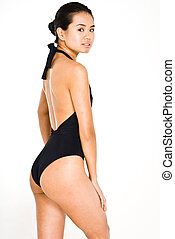 Black swim suit - Young attractive asian women in black...