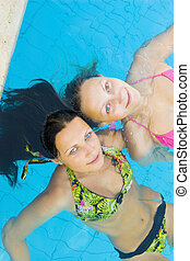 Two beautiul girls in a swimming pool - Two beautiul girls...