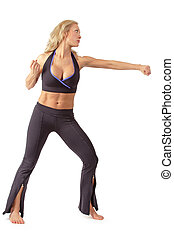 Girl training tae bo - Athletic tanned blond girl training...