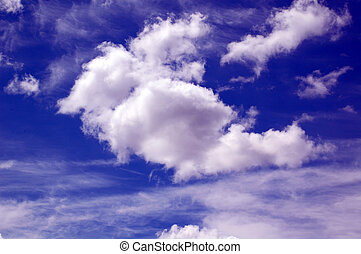 Puffy clouds against blue sky