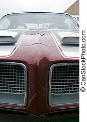 Muscle Car - Narrow, front, close-up view of a classic...