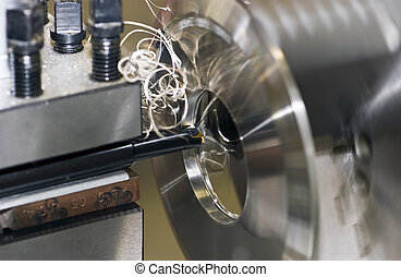 metal lathe - Fine turnings fly off a fast spinning metal...