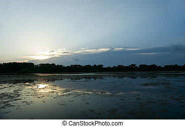 Swamp Sunset - A shot at dusk of the sunset over a small...