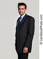 Business man - Handsome brunette young smiling business man...