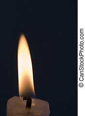 Candle flame - A single candle flame with a black background...