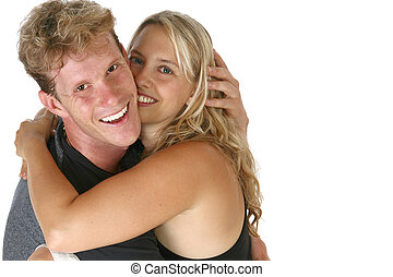 Couple Hugging Smiling - Thirty something caucasian couple...
