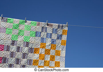 Patchwork counterpane on a clothes-line - Laundry. Bright...