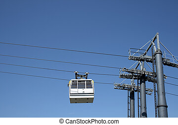 Cable car going up to the mountain - White cable car going...