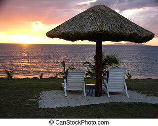 Fijian Sunset - Sunset, poolside at a beach resort on...