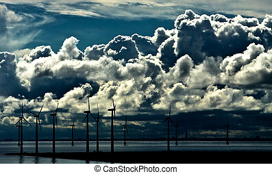 Wind Power - Windmills seen from the harbourarea in...