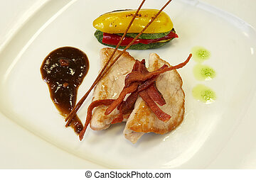 main dish of pork with grilled vegetables and berries sauce