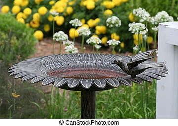 Bird Bath - Cast Iron Bird bath in a flower garden.