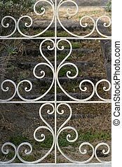 Wrought Iron Gate - Decorative gate opens on stone stairs...