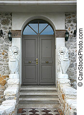 Majestic home porch with lion statues
