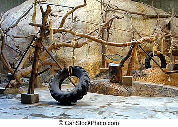 Zoo interior for chimpanzees with tires and trees