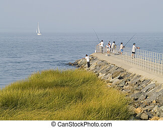 Pier Fishing - People fishing on a hazy afternoon in...