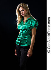 Green blouse - beautiful young woman with blond hair wearing...