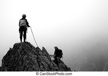 Climbers in National Park Retezat, Judele ridge, Romania