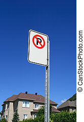 No parking sign in front of a new house