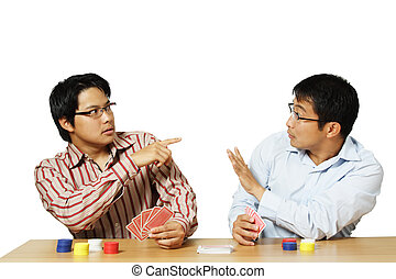 Poker game - An isolated shot of two men playing poker with...