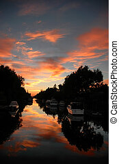 Water Canal Sunset - Reflection of Silhouette Treescape and...