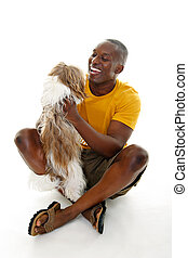 Casual Man With Dog - Happy casual man holding a happy dog....