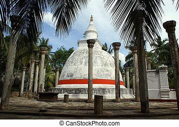 White dagoba and trees - Dagoba in Mihintale, Sri Lanka