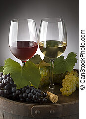 wine - glass of red and white wine with grapes close up