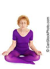 Senior Yoga - Meditation - A fit seventy year old woman...