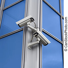 Cams - Two security cameras attached on building corner