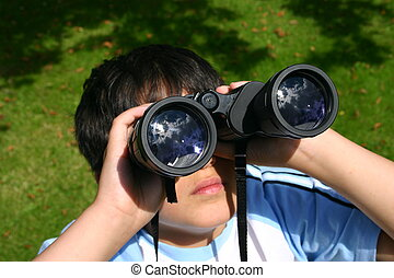 Boy Using His Binoculars - Boy using his binoculars focus on...