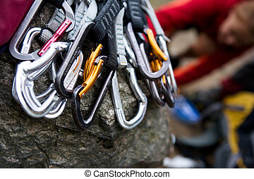 Quickdraws - A pile of quick draw carabiners with climbers...