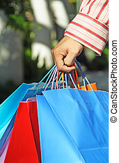 Shopping - A shot of a young man carrying shopping bags