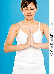 Yoga Meditation - A young Asian woman in white practising...