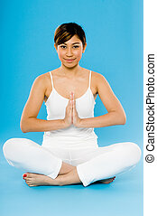 Yoga Practice - A young Asian woman in white practising yoga...
