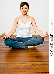Yoga Meditation - Woman doing yoga in a studio