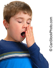 Boy Yawning - Boy with hand to mouth to cover yawn, isolated...