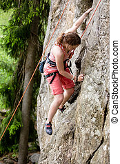 Female Climber - A female climber, climbing using a top rope...