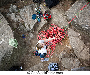 Female Belayer - A female climber belaying - viewed from...