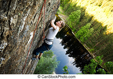 Female Climber - A female climber on a steep rock face...